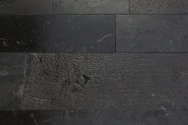 Stone floor with different finishes