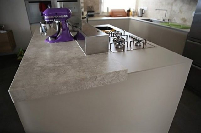 Stone cladding and kitchen top